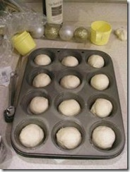 The rolls in a greased muffin pan, formed and waiting.